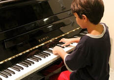 Jonathan learning some songs in a piano lesson in san jose!